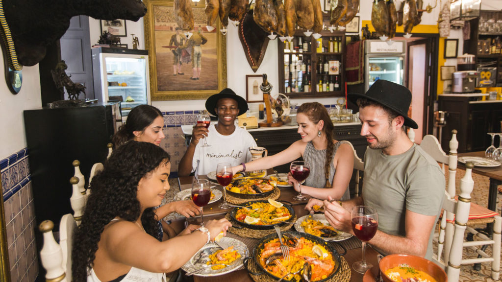 a group eating food - travel apps