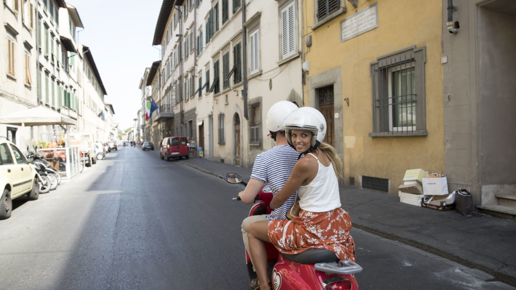trip to italy - girl exploring Florence by Vespa