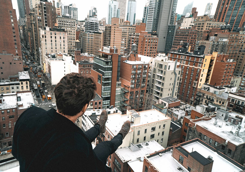 Instagrammable locations - man on rooftop in new york