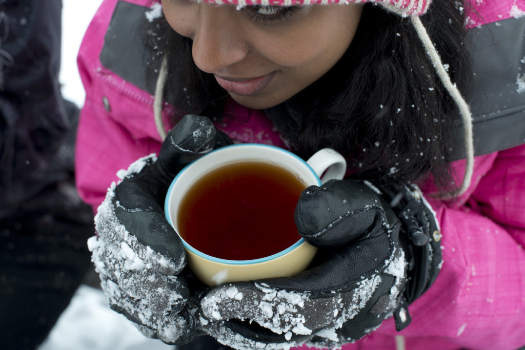 Cold girl drinking tea