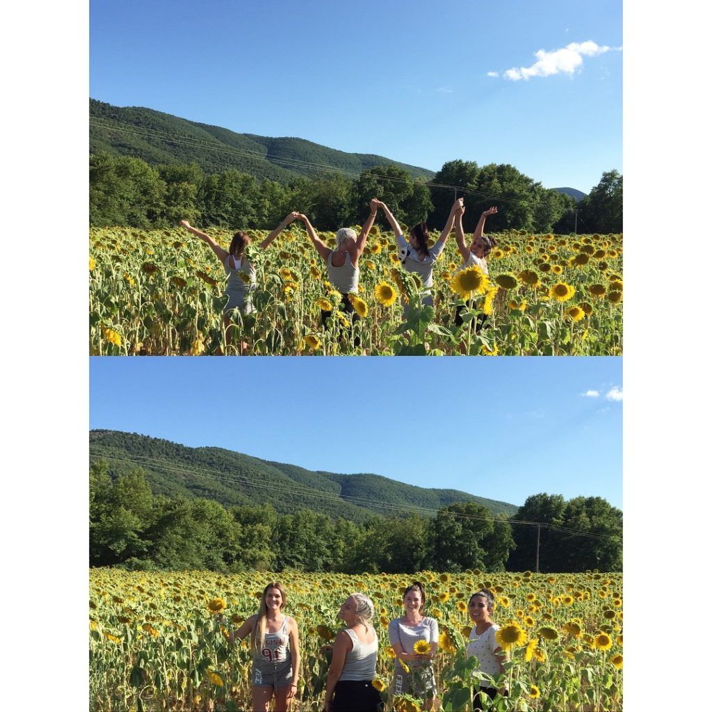 Girls in sunflower field