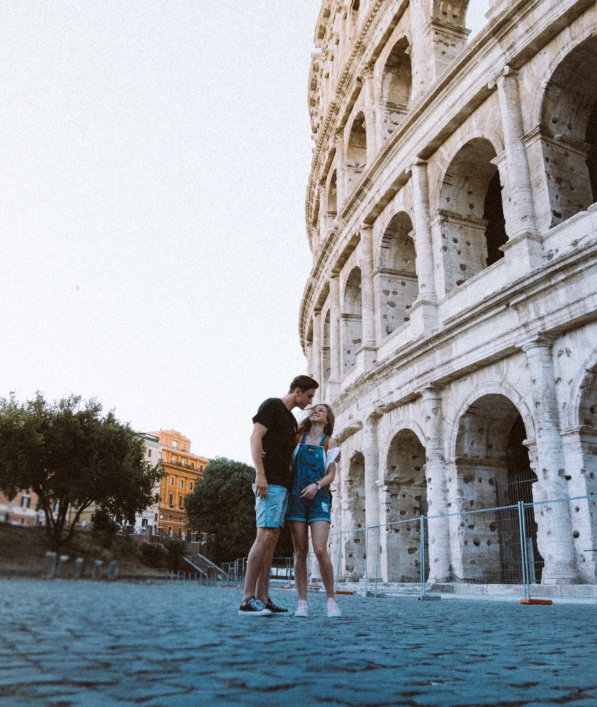 Couple in front of colosseum