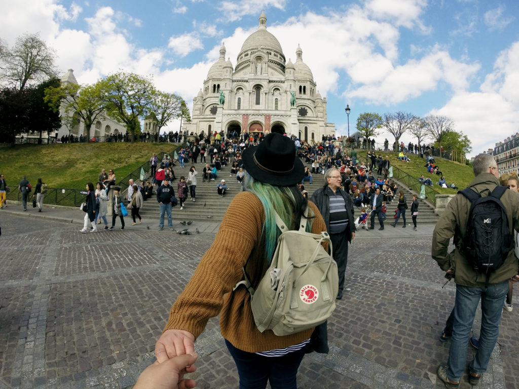 Girl-pulling-hand-to-Notre-Dame