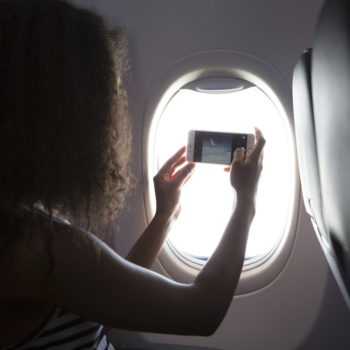 Girl taking picture on flight