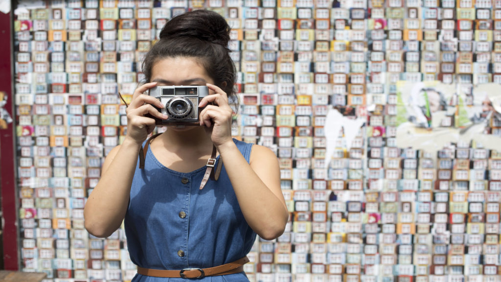 Girl-with-film-camera-disposable-camera-sales