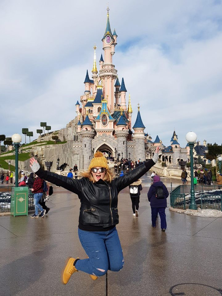 Girl-jumping-at-disneyland-travel-disease