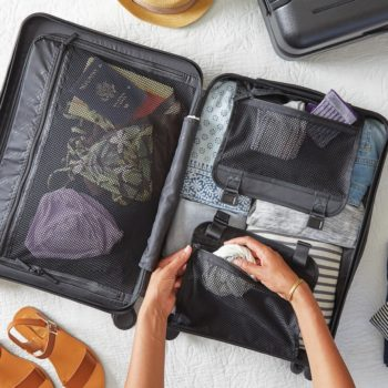 Woman packing a suitcase for a holiday