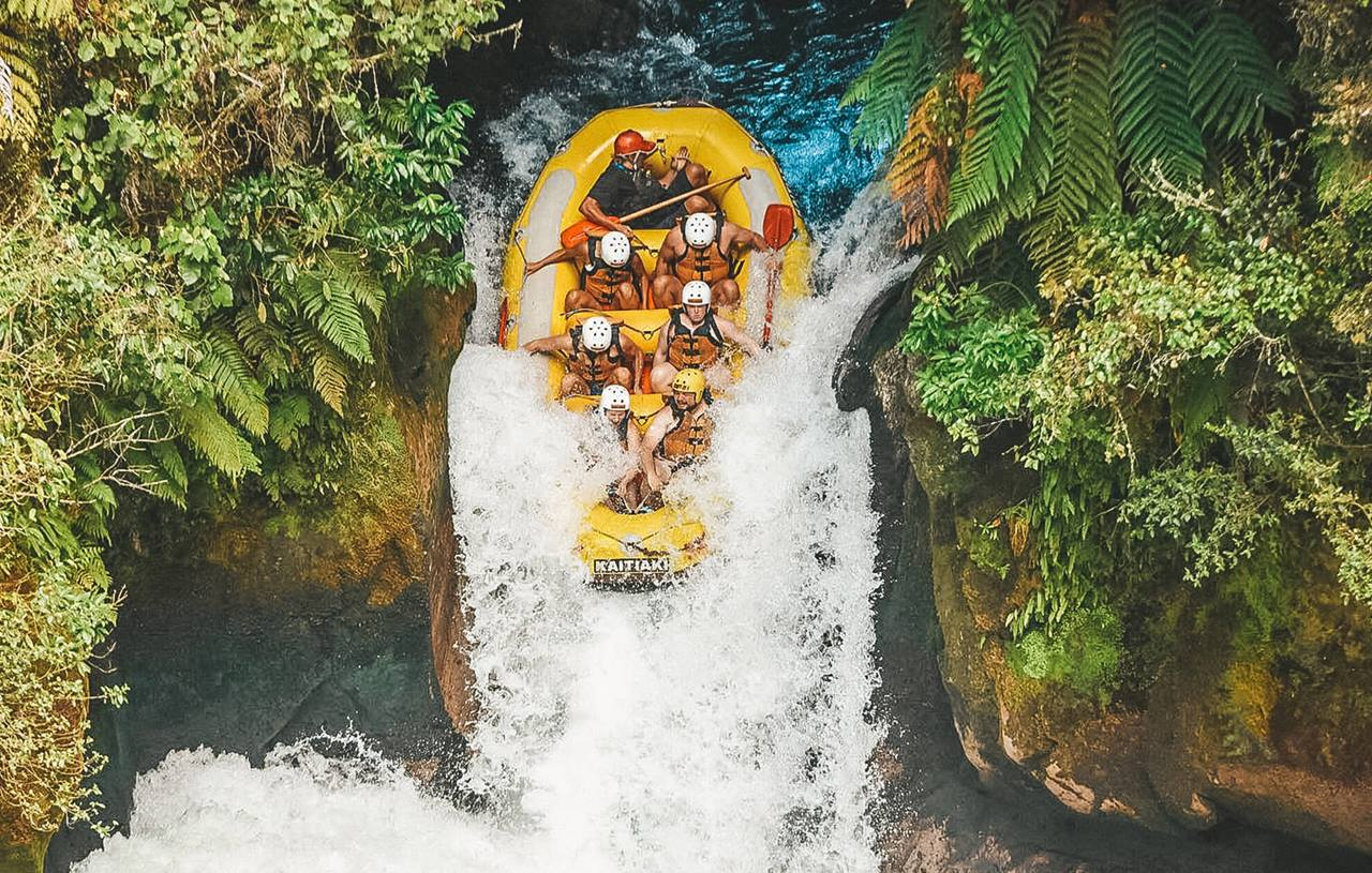 people white water rafting in New Zealand