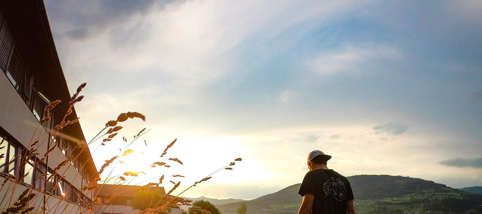 contiki-cares-climate-action-plan-sunset-fields-wondering