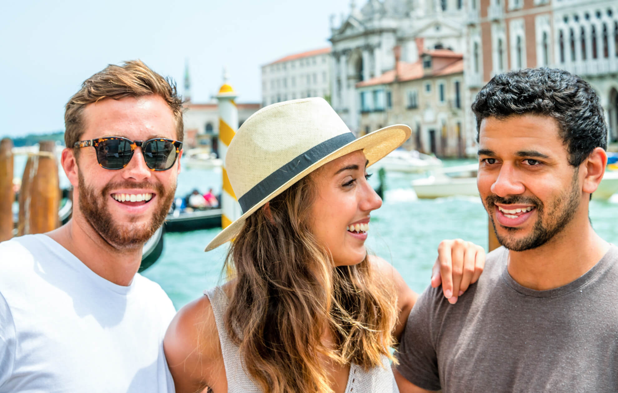 friends in front of Venice canal gondola stop