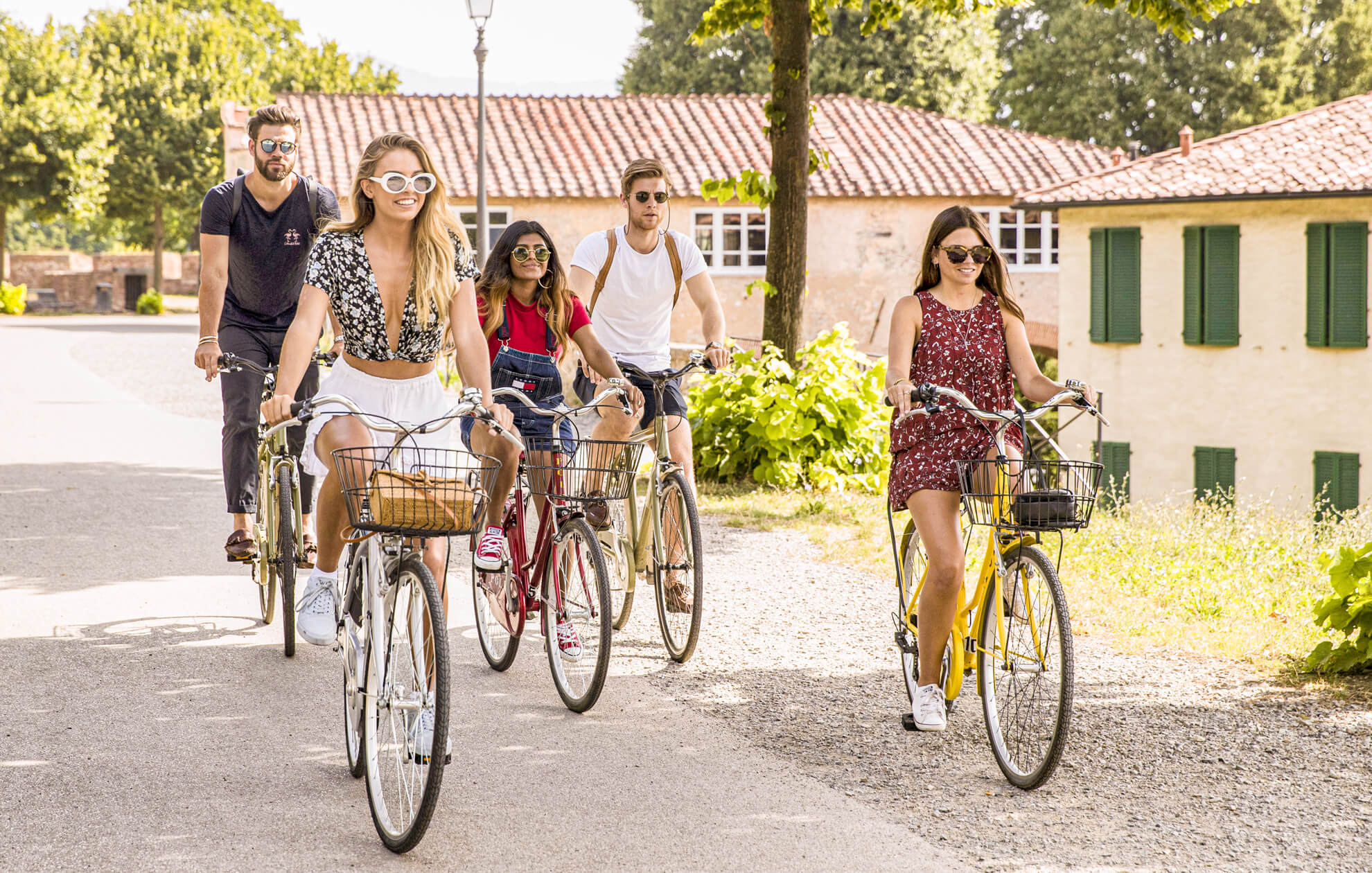 Group riding bikes in Italy