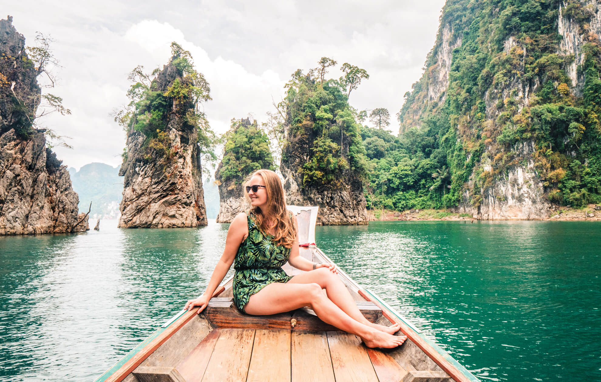 Girl on a boat in a river in Asia